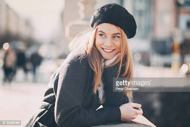 Smiling woman at sunlight
