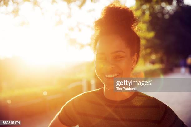 smiling woman at sunset - gold coloured stock pictures, royalty-free photos & images