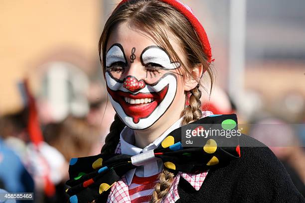 smiling woman at the carnival parade - happy clown faces stock photos and pictures