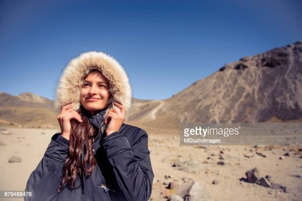 Smiling woman at the mountain.