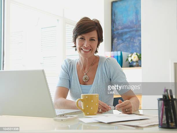 Smiling Woman Behind Desk