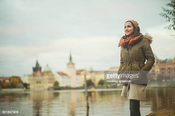 Smiling woman by the river