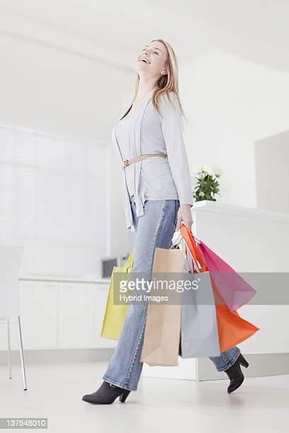Smiling woman carrying shopping bags