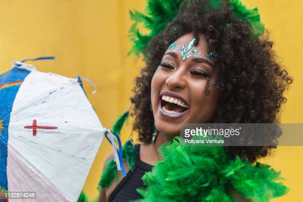 smiling woman celebrating the carnival in pernambuco, brazil - mardi gras photos stock pictures, royalty-free photos & images