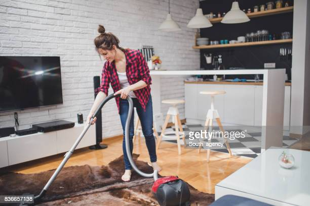 smiling woman cleaning the house - tv housewife stock photos and pictures