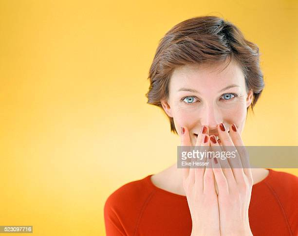 Smiling Woman Covering Her Mouth