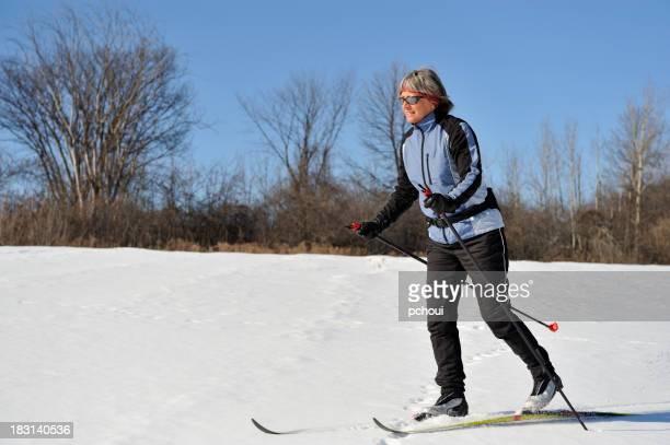 Smiling woman, cross-country skiing, winter sport