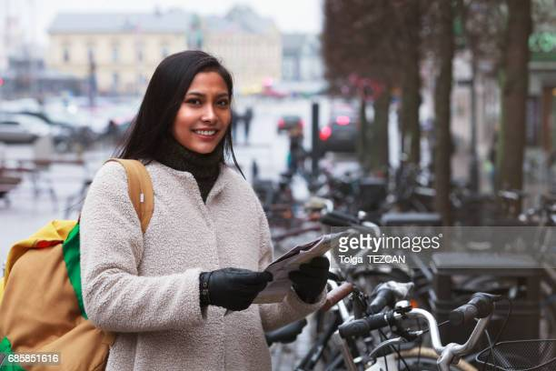 Smiling woman cycling in Helsingborg