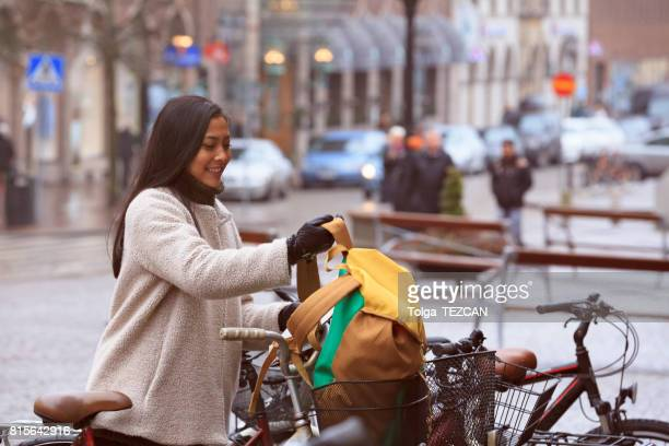 smiling woman cycling in helsingborg - helsingborg stock pictures, royalty-free photos & images