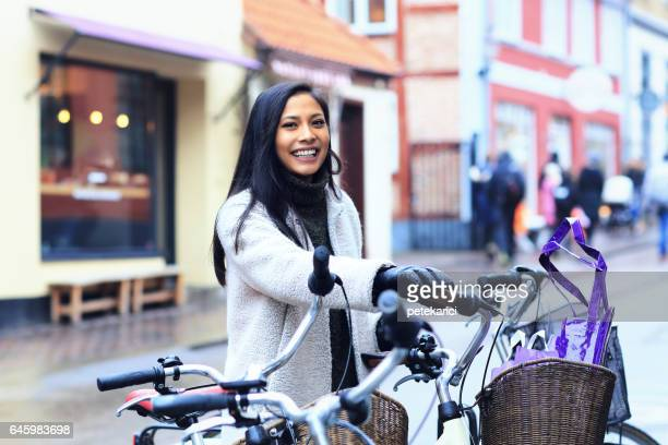 smiling woman cycling in helsingborg, sweden - helsingborg stock pictures, royalty-free photos & images