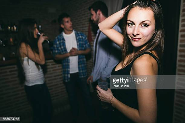 Smiling woman dancing in nightclub