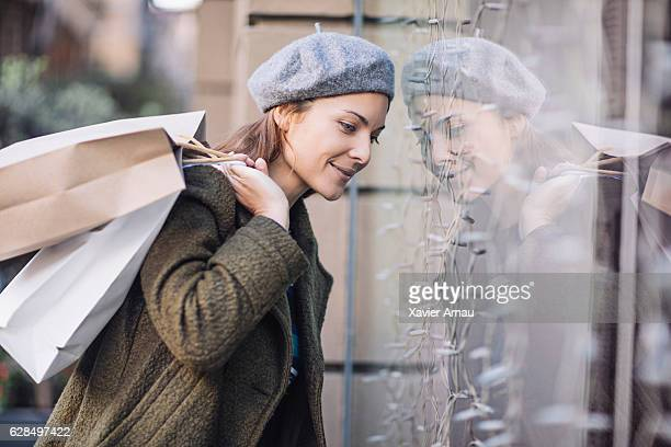 Smiling woman doing window shopping