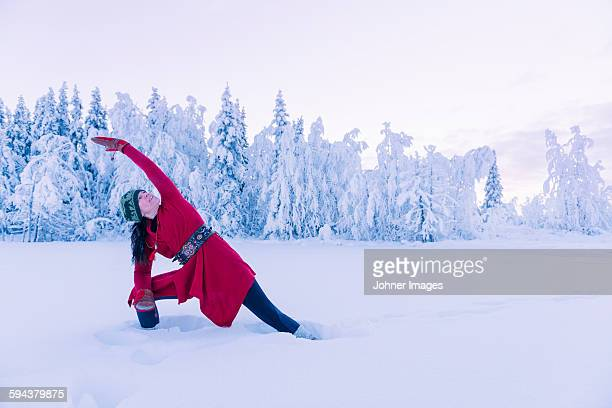 Smiling woman doing yoga