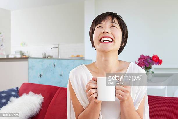 smiling woman drinking cup of coffee - 飲食 ストックフォトと画像