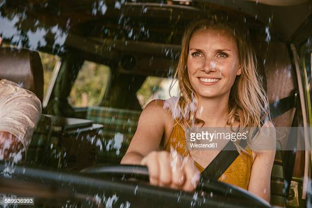 Smiling woman driving van