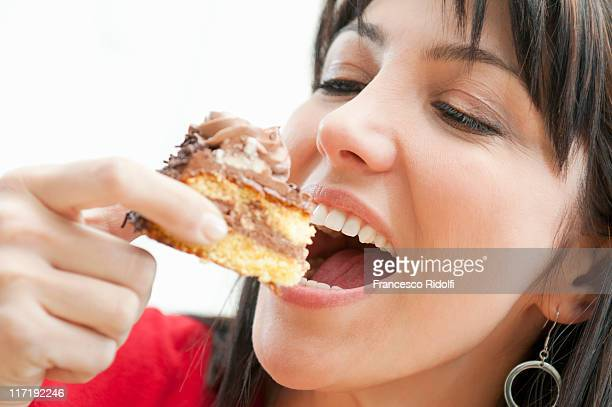 Smiling woman eating chocolate cake