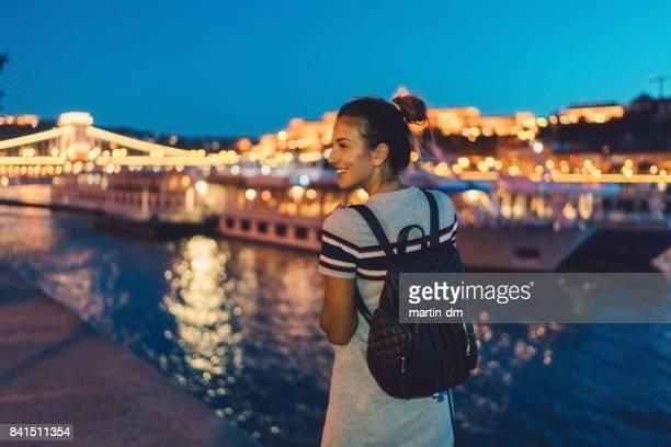 Smiling woman enjoying Budapest at night