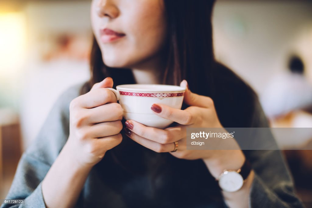 Smiling woman enjoying coffee : Stock Photo