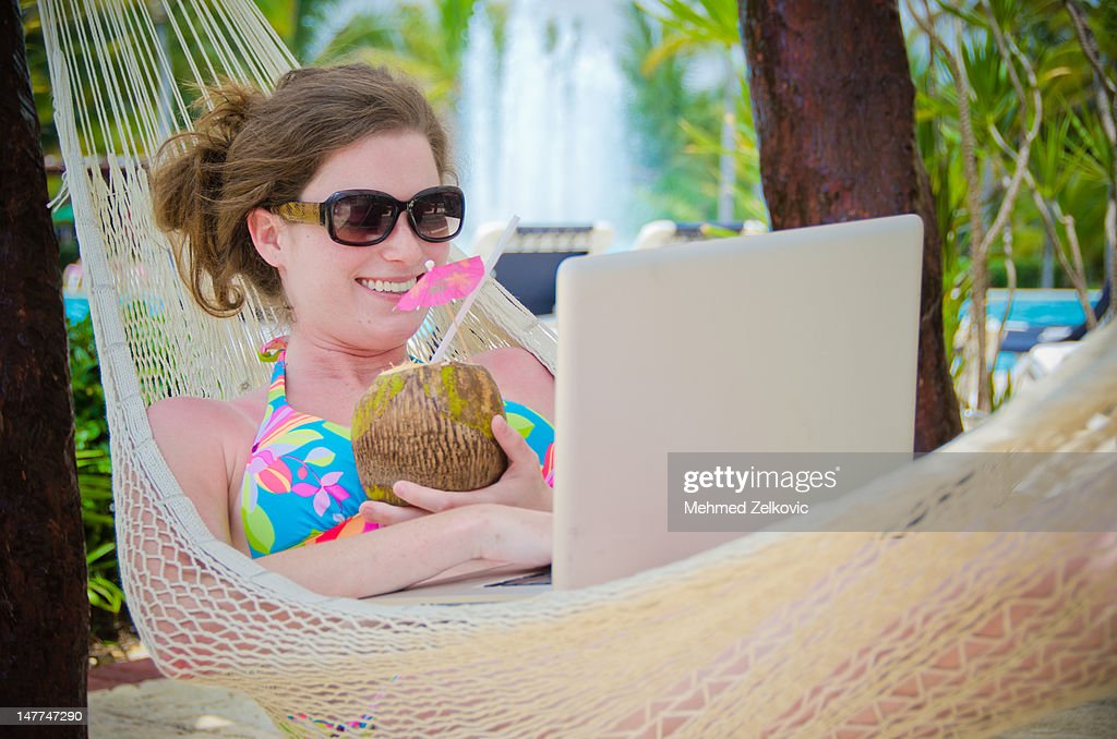 Smiling woman enjoying her summer vacation : Stock Photo