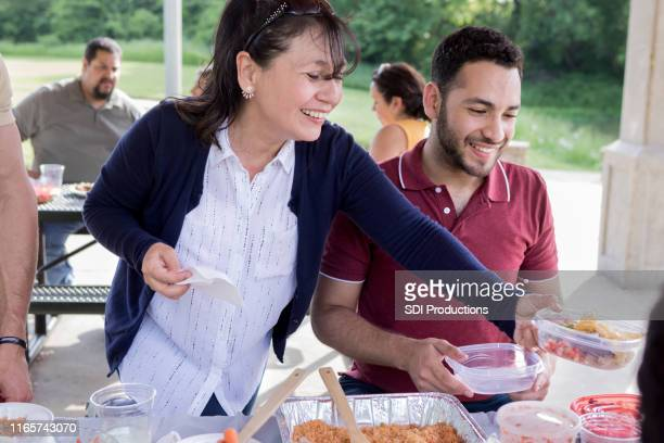 smiling woman enjoys family picnic - zia e nipote foto e immagini stock