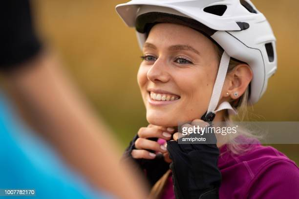 smiling woman face white cycling helmet - cycling helmet stock pictures, royalty-free photos & images