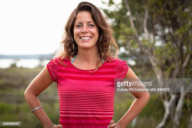 Smiling woman, field in background