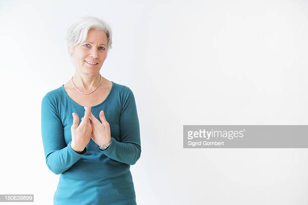 Smiling woman gesturing with hands