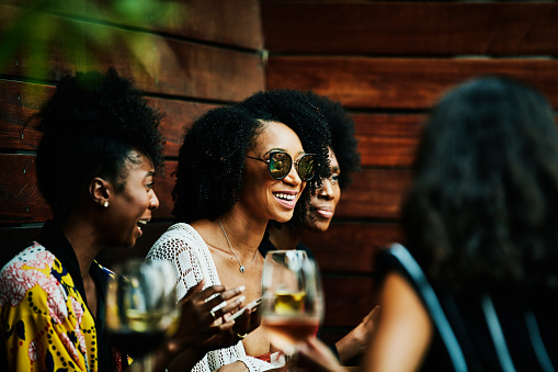 Smiling woman hanging out with friends at poolside bar - gettyimageskorea