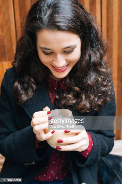 Smiling Woman Having Coffee While Sitting At Home