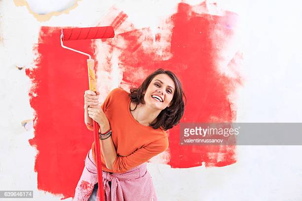 Smiling woman having fun and decorating