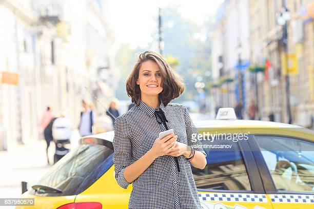 Smiling woman having fun on street