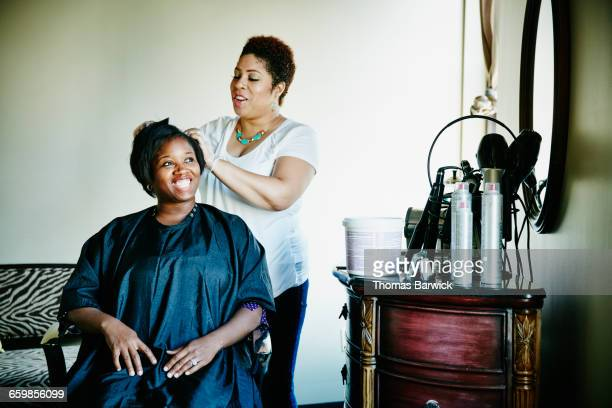 Smiling woman having haircut in salon