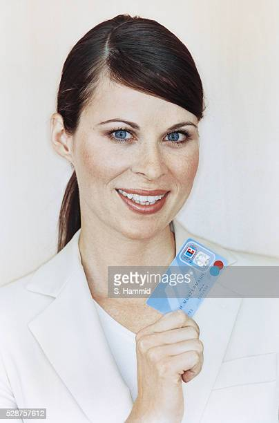 Smiling Woman Holding Debit Card