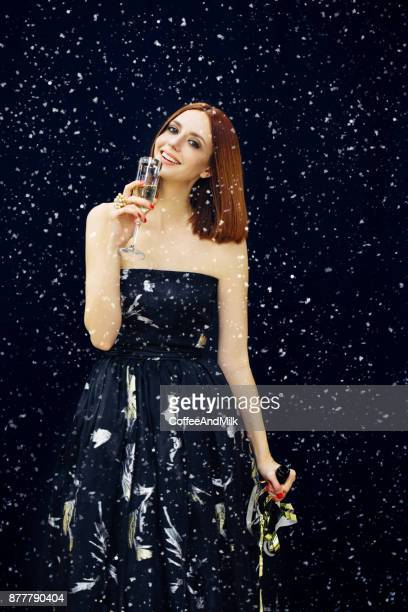 smiling woman holding glass of sparkling wine - woman flashing stock photos and pictures