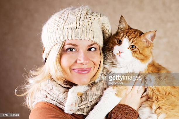 Smiling woman holding her cute cat