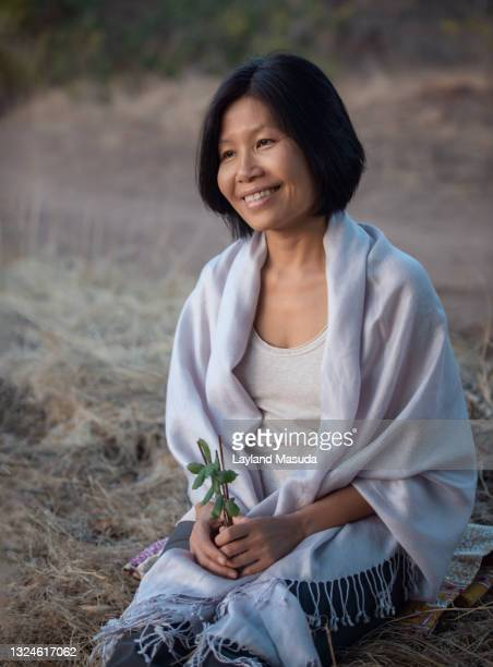 smiling woman holding incense and leaves - shawl stock pictures, royalty-free photos & images