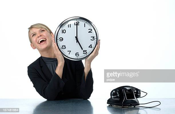 smiling woman holding office clock