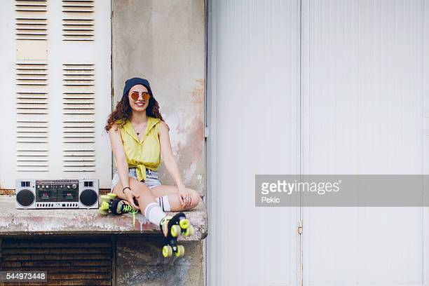Smiling woman holding retro boom box