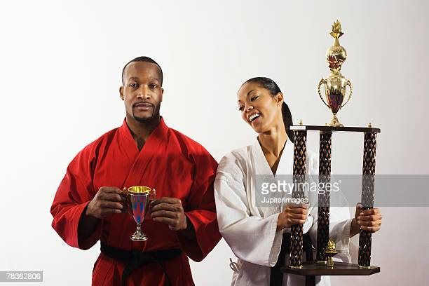 Smiling woman holding trophy