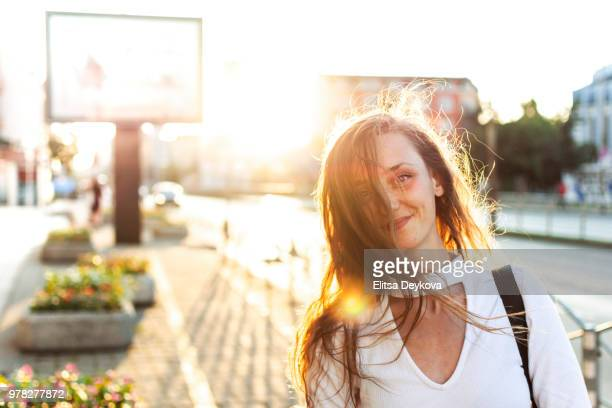 Smiling woman in a city street