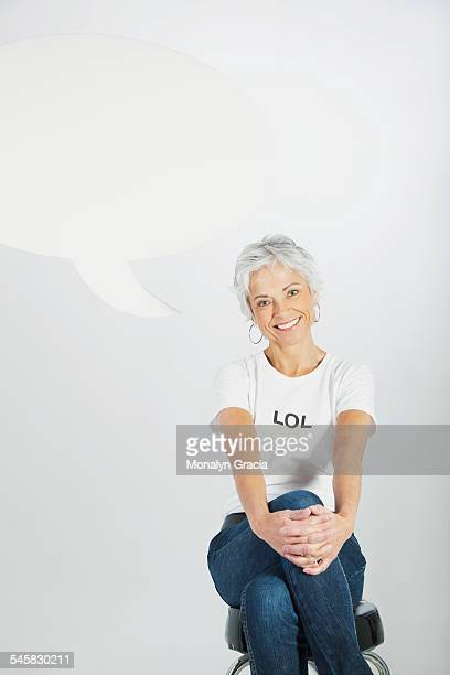 Smiling woman in an LOL t-shirt