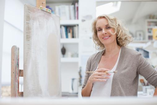 Smiling woman in art studio - gettyimageskorea