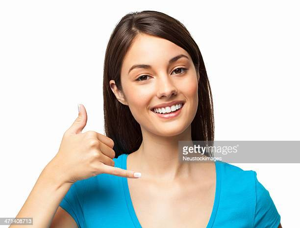 Smiling woman in blue shirt with call me hand gesture