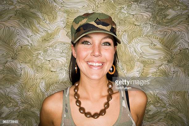 smiling woman in camo - camouflage clothing stock pictures, royalty-free photos & images