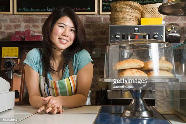 Smiling woman in coffee shop