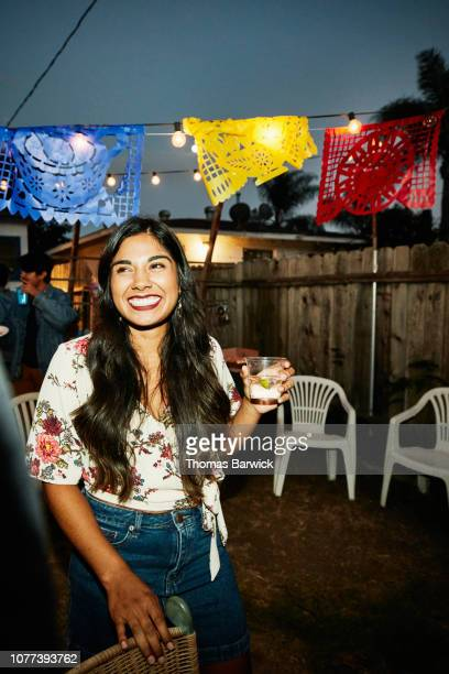 smiling woman in discussion with friends during backyard party on summer evening - funny bbq stock pictures, royalty-free photos & images