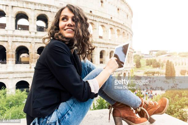 Smiling woman in front of Colosseum