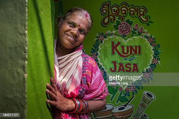 CONTENT] Smiling woman in front of her beautiful green coloured house in Bhubaneswar Orissa India