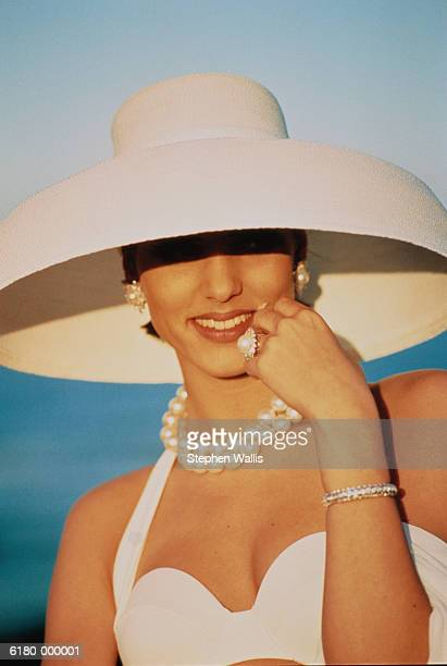 smiling woman in hat - dress hat stock pictures, royalty-free photos & images