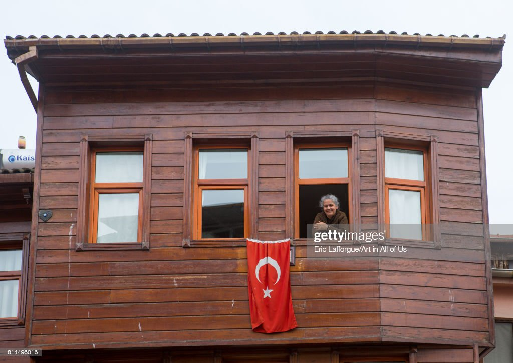 Smiling woman in her old wooden style house near the Bosphorus sea, Marmara Region, Istanbul, Turkey on April 27, 2014 in Istanbul, Turkey.
